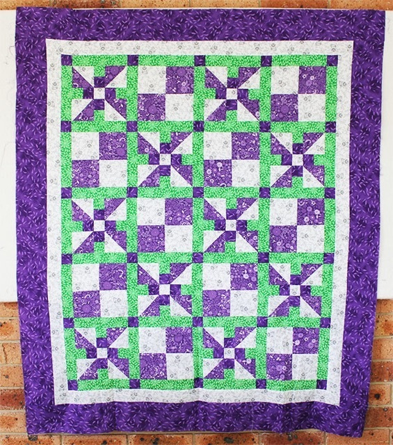 snuggle-blossom-purple-crib-quilt,quilting,craft,sewing
